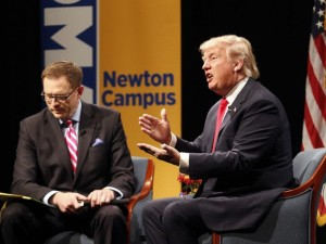 Republican presidential candidate Donald Trump speaks with host Dave Price during the WHO-HD Iowa Forums at the Des Moines Area Community College Newton Campus, Thursday, Nov. 19, 2015, in Newton, Iowa.  Matthew Holst/Associated Press