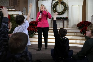 Democratic presidential candidate Hillary Clinton takes questions as children raise their hands during a town hall style campaign event, Tuesday, Dec. 29, 2015, at South Church in Portsmouth, N.H. (AP Photo/Steven Senne)