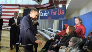 Gov. Kasich speaking with Michelle Fridley and other disability activists following a town hall in Greece, New York on Friday, April 9.