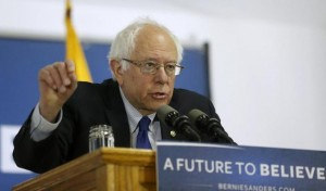 Image of Bernie Sanders standing behind podium with sign saying A Future to Believe