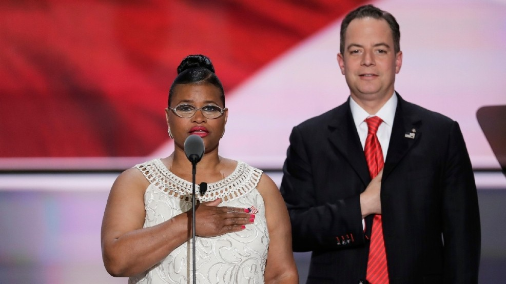 Margo Hudson, graduate of Seeds of Liberty delivers the Pledge of Allegiance as Reince Priebus, Chairman of the Republican National Committee, stands in the background during the third day of the Republican National Convention in Cleveland, Wednesday, July 20, 2016. (AP Photo/J. Scott Applewhite)