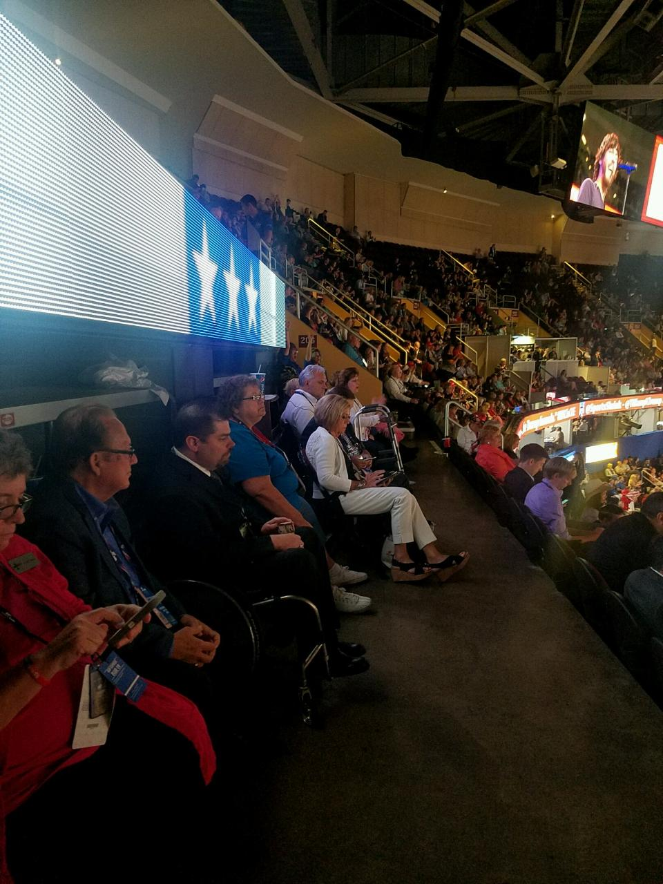 Image shows people in wheelchairs and with other disabilities seated at an ADA section at the RNC