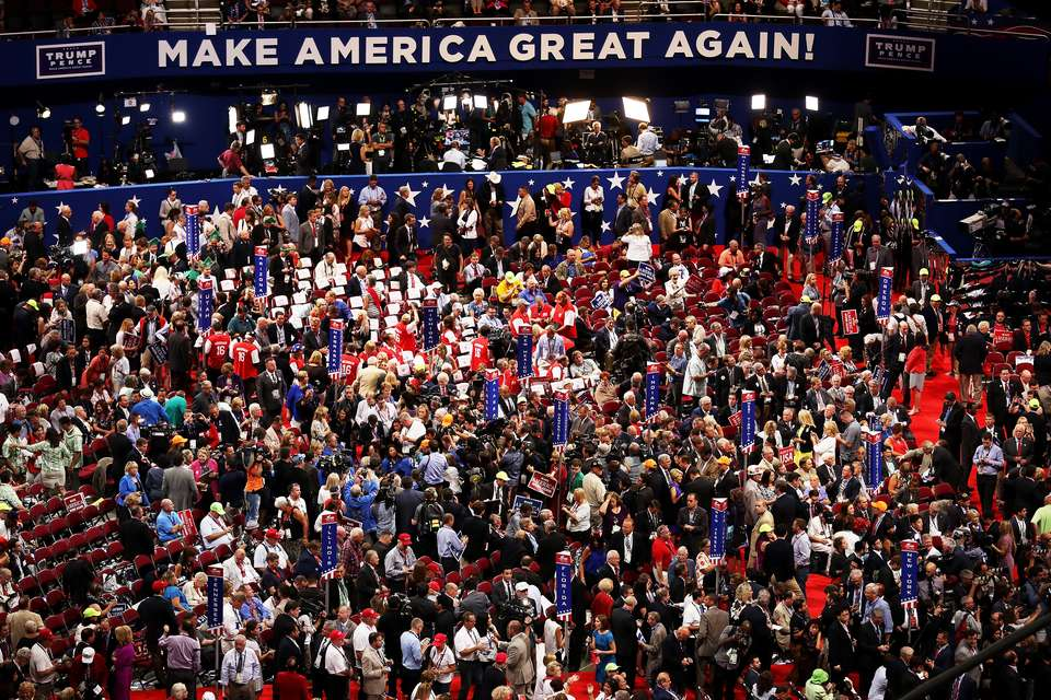 "crowd shot of RNC with sign in back saying ""Make America Great Again"""