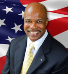 Headshot of Dwight Young with American flag in background