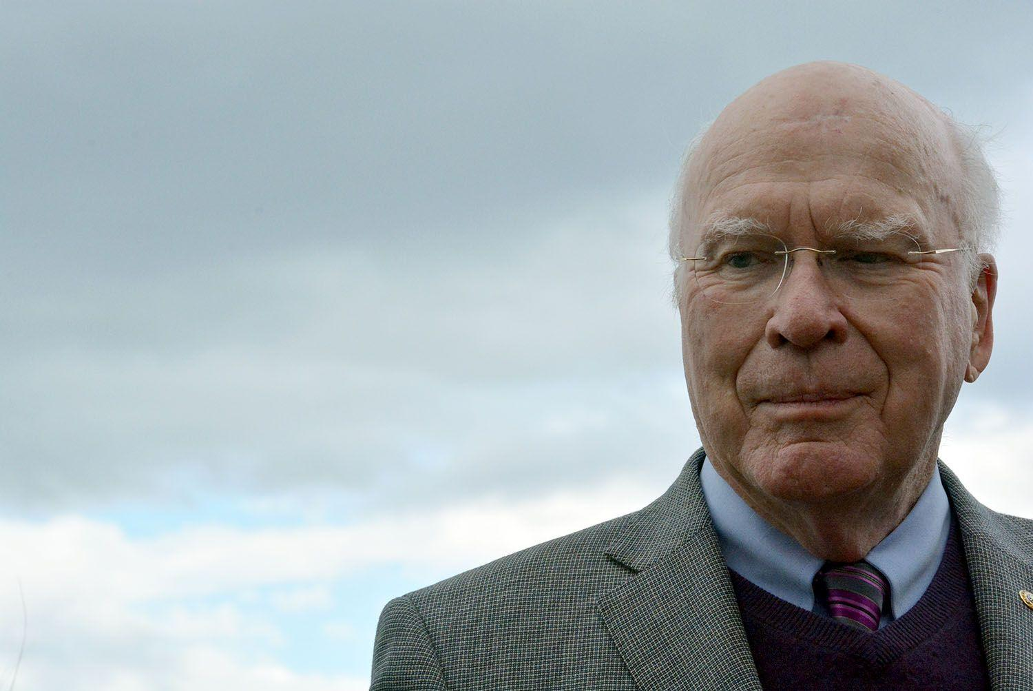 Patrick Leahy standing outside with clouds in the background