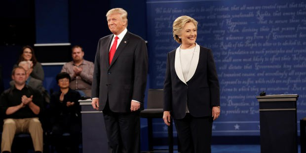 Republican U.S. presidential nominee Donald Trump and Democratic U.S. presidential nominee Hillary Clinton appear together during their presidential town hall debate at Washington University in St. Louis, Missouri, U.S., October 9, 2016. REUTERS/Mike Segar - RTSRIKQ