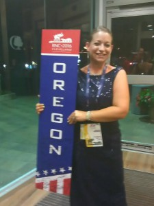 Narlina Duke standing holding an Oregon sign from the RNC