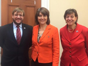RespectAbility's Philip Pauli, Rep. Cathy McMorris Rodgers and RespectAbility's Jennifer Laszlo Mizrahi standing and posing for photo while smiling, wearing black, orange and red suits respectively