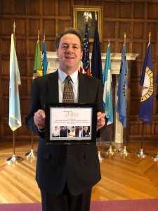 Governor Bullock of Montana holding an award from respectability