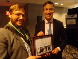 Governor John Hickenlooper holding an award from RespectAbility along with Phillip Pauli