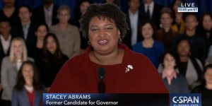 Stacey Abrams speaking in front of a crowd of supporters on CSPAN
