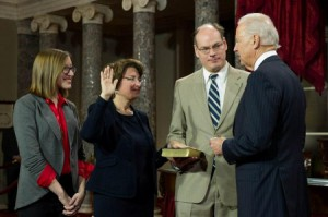 Amy Klobuchar, accompanied by her family, being sworn in by Vice President, Joe Biden