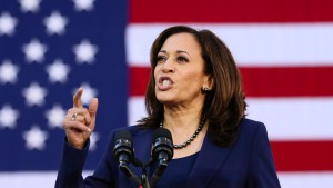 Kamala Harris speaks in front of a large U.S. flag