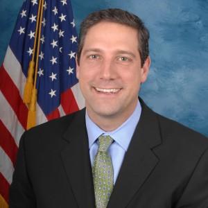 Rep. Tim Ryan smiling in front of an American flag