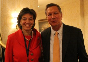 Photo of RespectAbility President Jennifer Laszlo Mizrahi  talking about disability issues with Gov. John Kasich
