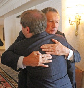 Picture of Gov. Kasich hugs RespectAbility Fellow James Trout while talking about autism