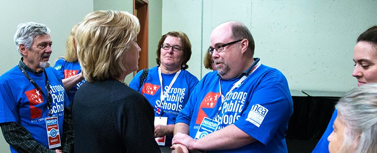 Hillary Clinton met with Keith, whose mother has Alzheimer's, backstage before a town hall.