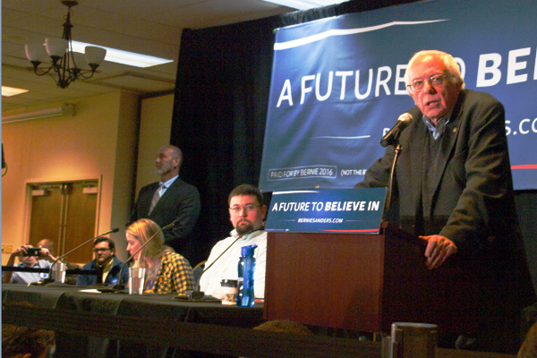 Image of presidential candidate Bernie Sanders speaking at a town hall.