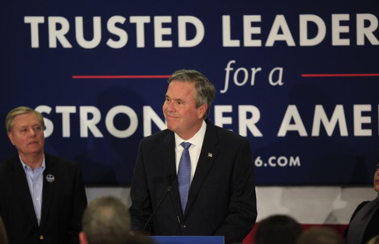 Jeb Bush giving his concession speech in Columbia, S.C., with Sen. Lindsay Graham in the background
