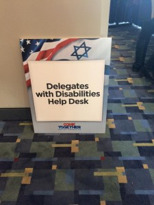 Text on Sign: Delegates with Disabilities Help Desk