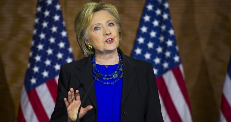 Image of Hillary Clinton talking in front of two American flags