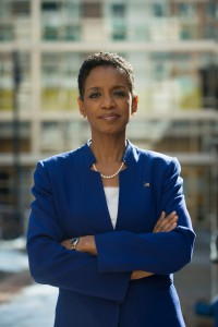 IMAGE Rep Donna Edwards D-MD, wearing a blue suit, stands before a blurry background.
