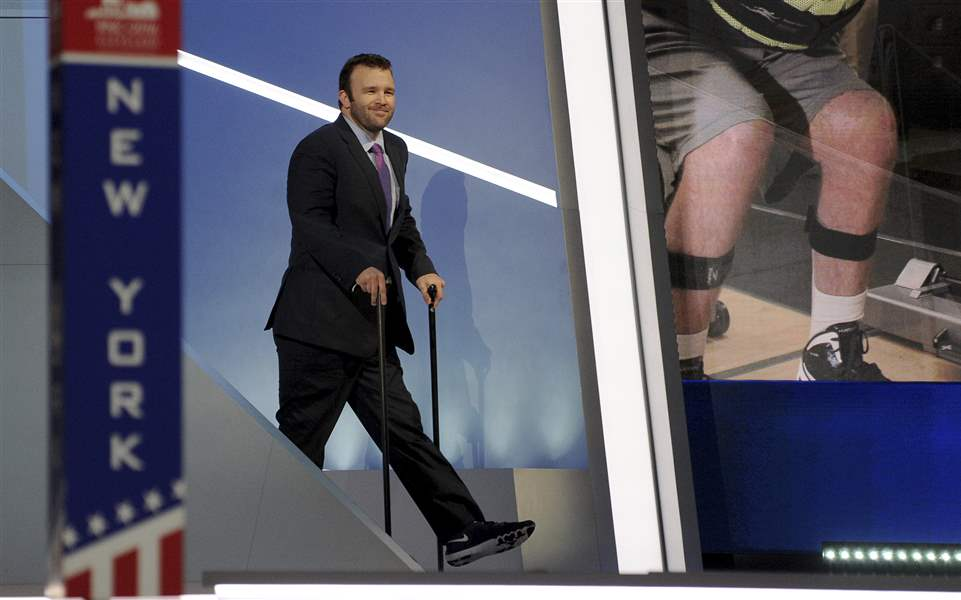 Brock Mealer walks onto the RNC stage using two canes