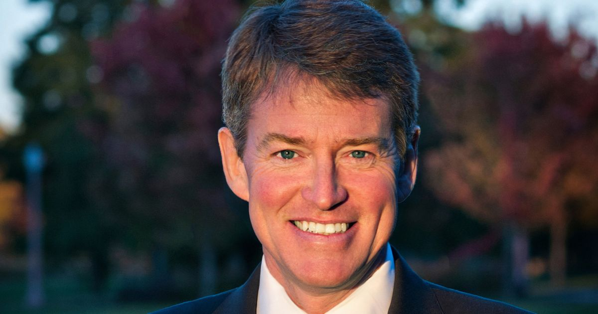 Official portrait of Chris Koster, outside with trees in background