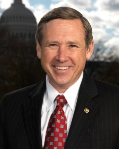 Head shot of Mark Kirk with Capitol in background
