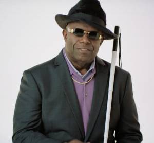 A blind man holding a walking stick who was featured in the video for Indiana's new campaign on disability awareness