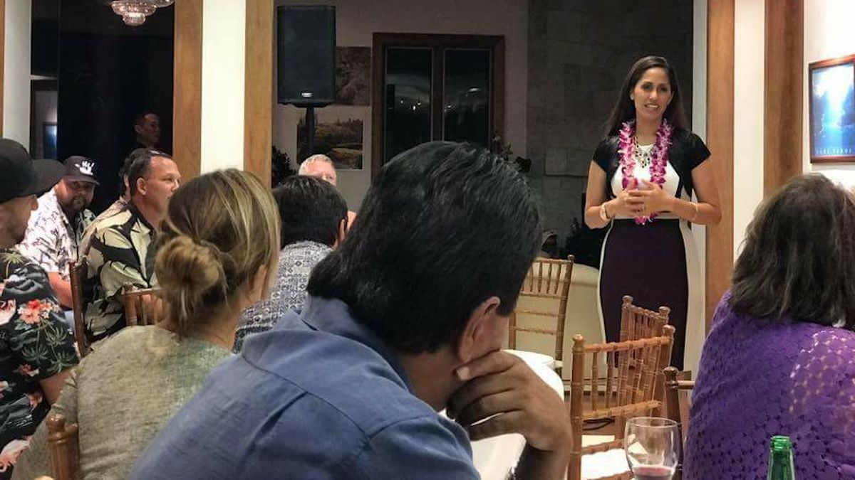 Andria Tupola speaks to a group of pepole