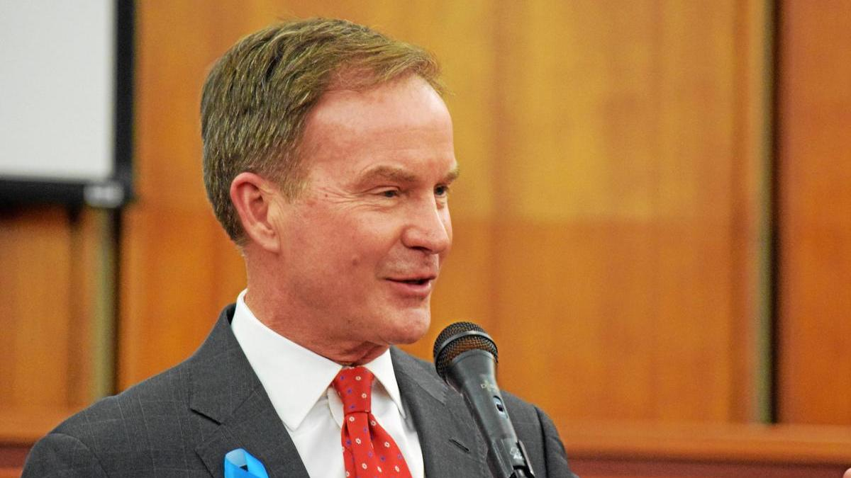 Bill Schuette speaking into a microphone