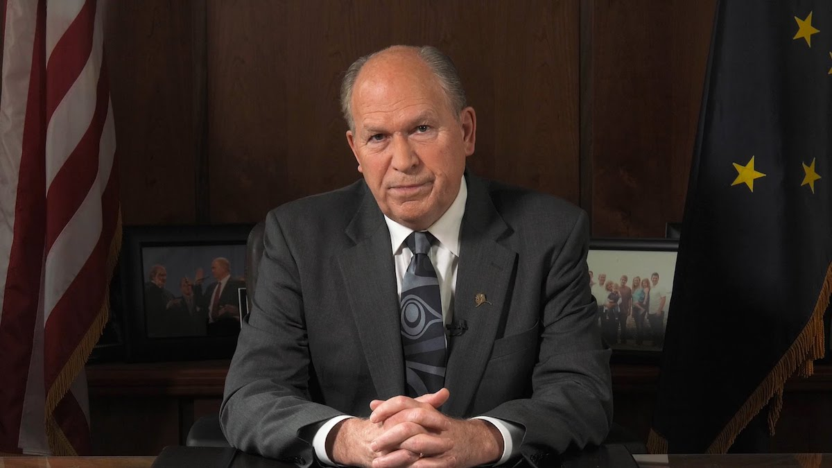 Bill Walker sitting behind his desk