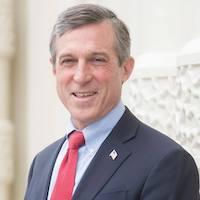 Delaware Governor John Carney smiling