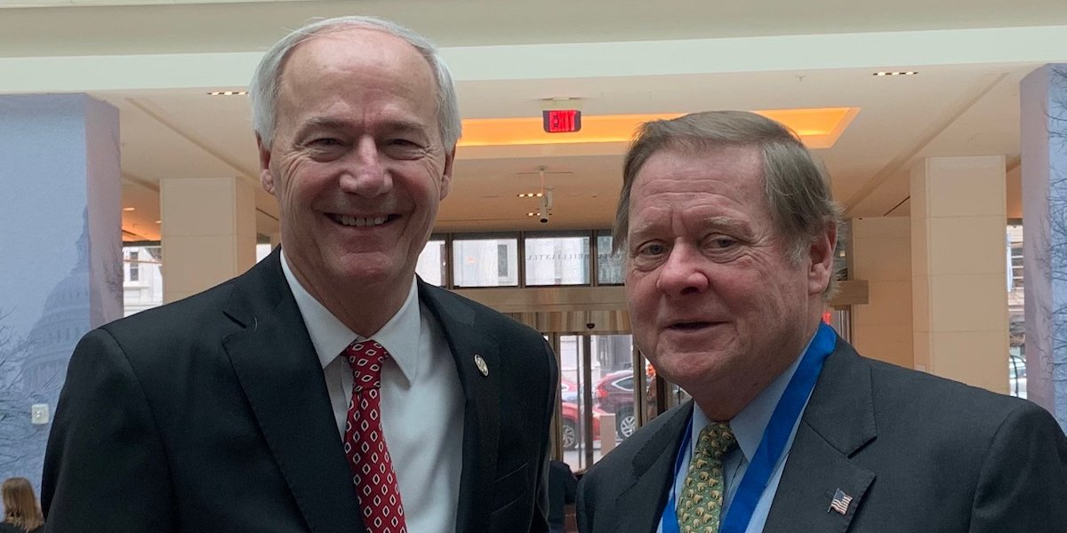 Arkansas Governor Asa Hutchinson and RespectAbility Chairman Steve Bartlett smile together