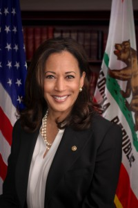 head shot of Kamala Harris in front of the U.S. and C.A. flags