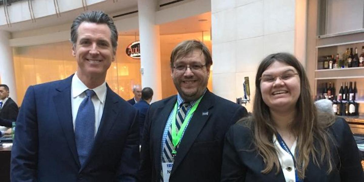 L-R: Gavin Newsom, Philip Kahn-Pauli, and Heidi Wangelin smile together in the Marriot Marquis lobby