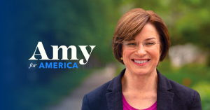 "Amy Klobuchar next to her slogan, ""Amy for America"""