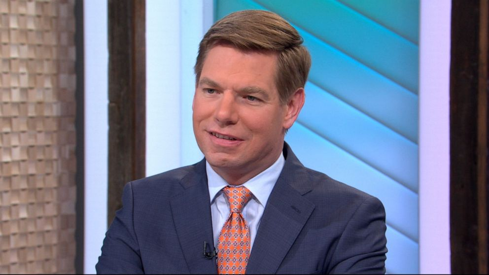 Swalwell smiles away from the camera
