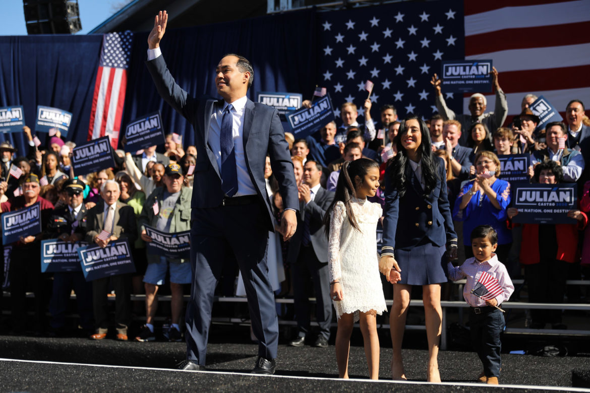 Castro and his family wave to the crowd of supporters at his launch rally
