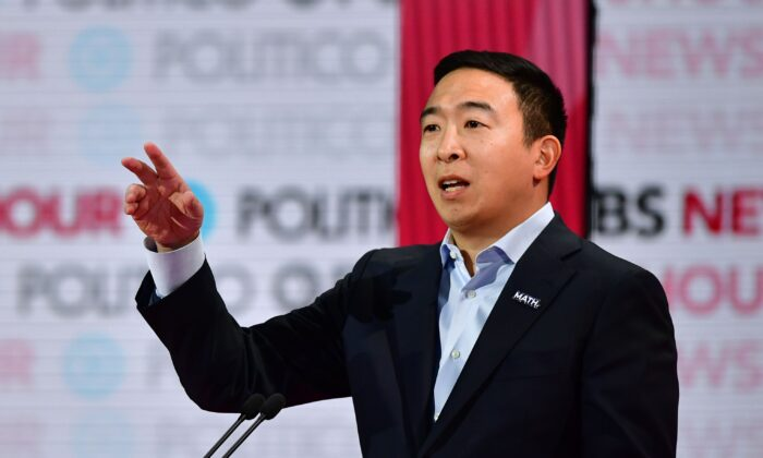 Andrew Yang standing during PBS NewsHour Politico Debate