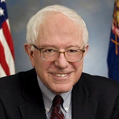 close-up of Bernie Sanders smiling while wearing a suit and a tie