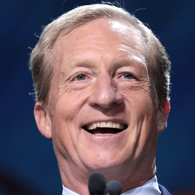 Tom Steyer smiling while giving a speech