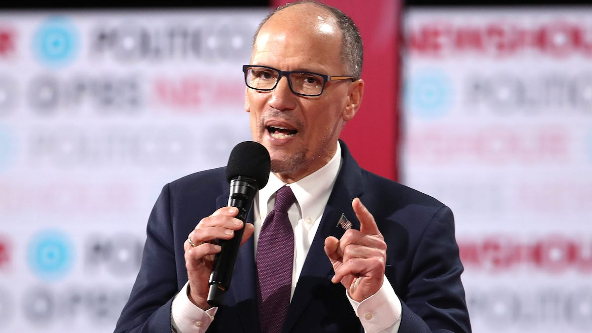 Tom Perez speaks on stage prior to the Politico/PBS NewsHour Democratic Primary Debate