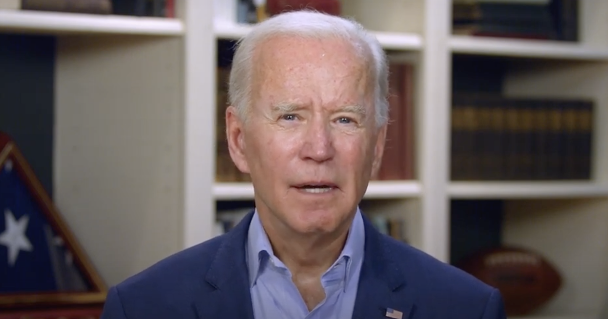 Joe Biden speaks from his home in front of books and other things on shelves