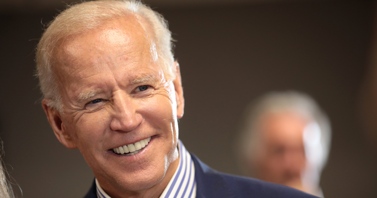 Joe Biden smiling wearing a suit