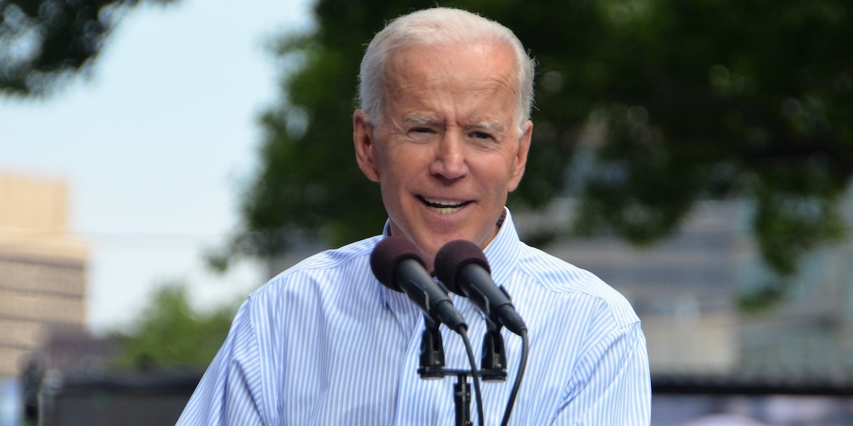 Joe Biden speaks behind a microphone at his campaign kickoff rally in 2019